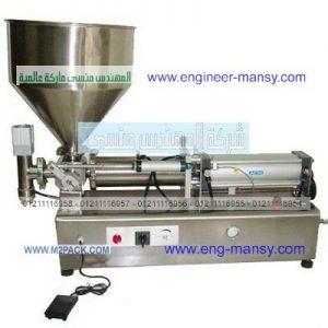 ماكينة تعبئة أفقية نصف أتوماتيك تستخدم لتعبئة عسل التمر في عبوات ماركة ام توباك